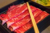 stock photo of wagyu  - Close up of Marbled Japanese beef with chopsticks - JPG