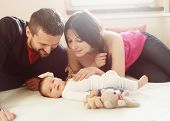 Parents with little baby at home
