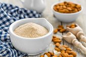 stock photo of ground nut  - Almond flour and dry nuts on a wooden table