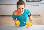 Portrait Of Happy Fitness Young Woman With Pumpkin Smoothie In Kitchen