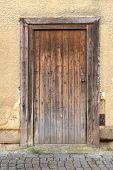 Weathered brown wooden door