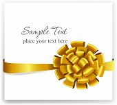 Gold gift bow with ribbons.