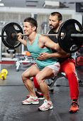 Athlete Doing Assisted Barbell Squats