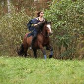 foto of appaloosa  - Nice girl riding a horse without bridle or saddle in autumn