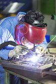 stock photo of manufacturing  - operator repair mold by TIG welding in manufacturing factory - JPG