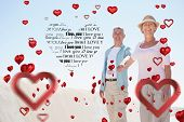 Happy senior couple walking on the pier against valentines day pattern