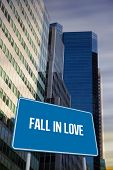 The word fall in love and blue billboard against low angle view of skyscrapers