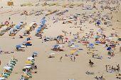 People sunbathe at Praia da Rocha beach in Portimao, Portugal.