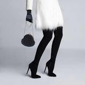stock photo of stocking-foot  - Beautiful slender female legs in elegant boots stockings - JPG