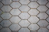 stock photo of paving  - dirty patterned paving tiles dirty cement brick floor background - JPG