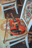 pic of violin  - Classic music violin vintage close up. Violin on chair ** Note: Visible grain at 100%, best at smaller sizes - JPG