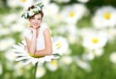 stock photo of thumbelina  - beautiful woman with diadem on daisy flower - JPG