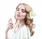 foto of perfume  - Beautiful young woman with perfume bottle isolate on white - JPG
