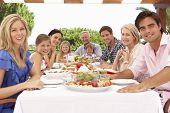 pic of extend  - Extended Family Group Enjoying Outdoor Meal Together - JPG