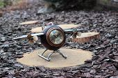 picture of propeller plane  - Alarm clock in the form of the plane with propeller on a wooden stub - JPG