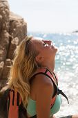 picture of wild adventure  - Adventure girl playing with her hair on the wild coast - JPG