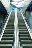 foto of roof-light  - escalator at the airport and a metal roof and blurred lights - JPG