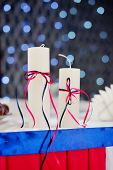 pic of adornment  - adorned decor with two candles on the background bokeh - JPG