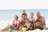 foto of extended family  - Portrait Of Three Generation Family On Beach Holiday - JPG