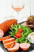picture of charcuterie  - charcuterie plate with wine bread and tomatoes - JPG