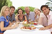 foto of extend  - Extended Family Group Enjoying Outdoor Meal Together - JPG