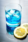 stock photo of curacao  - Glass Of Blue Curacao Cocktail With Slice Of Lemon - JPG