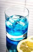 pic of curacao  - Glass Of Blue Curacao Cocktail With Slice Of Lemon - JPG
