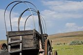 stock photo of wagon  - Covered Wagon Facing the Long Road Ahead - JPG