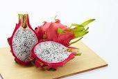 stock photo of dragon fruit  - dragon fruit slicing on chop block in white background - JPG
