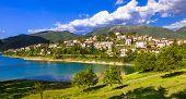 stock photo of tora  - Scenic lake Turano and village Colle di Tora - JPG