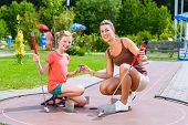 stock photo of miniature golf  - Family playing miniature golf in summer - JPG