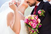 image of bridal veil  - Bridal pair kissing under veil at wedding - JPG