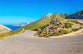 stock photo of greek-island  - Road turn with sea coast in background on Greek island - JPG