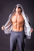 image of fitness man body  - Guy in a sports jacket and sunglasses - JPG