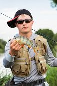 foto of catch fish  - Fisherman on the river bank - JPG