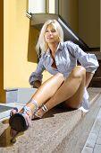 blonde frivolous sexy executive secretary in a courtyard