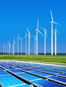 environmentally benign solar panels and wind turbines generating electricity