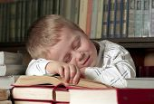 child asleep on books