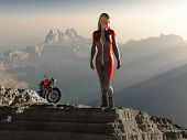 biker woman on mountain peak
