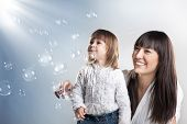 Smiling woman and her daughter