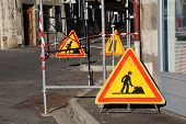 Warning Signs And Scaffolding In Street