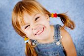 Funny playful little girl on blue