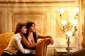 a young couple in a luxury sitting room of hotel