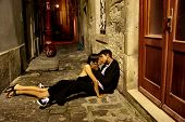 a young couple on the street on the night