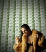 beautiful rich woman with money background