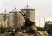 Guns Of Military Vehicle Against Buildings In Kiev poster