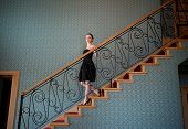 foto of snob  - Beautiful woman on a stairs - JPG