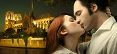 sweethearts kissing with notre dame de paris on the background