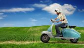 woman driving a moped in the countryside