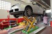 car on a lift in a garage
